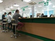 Customer making banking transactions at the counter Royalty Free Stock Images