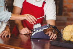 Customer making a mobile payment Royalty Free Stock Images