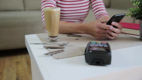 Customer making wireless or contactless payment using smartphone, nfc payment stock footage