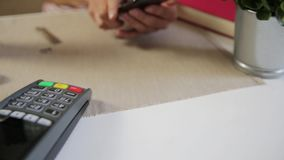 Customer making wireless or contactless payment using smartphone, nfc payment stock video