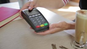 Customer making wireless or contactless payment using smartwatch. Store worker accepting payment with nfc technology stock video footage