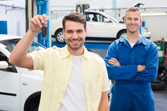 Customer and mechanic smiling at camera Stock Photo
