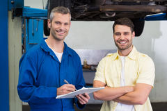 Customer and mechanic smiling at camera Stock Photos