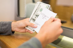 Customer with money and receipt at bank counter. People, withdrawal, saving and finance concept - customer with money and receipt at bank office or currency Royalty Free Stock Photos