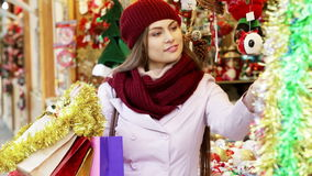 Customer near counter with Christmas gifts. Portrait of female customer near counter with Christmas gifts stock video footage