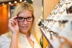 Customer in optometrist's shop choosing the right frame Royalty Free Stock Photography