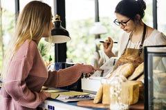 Customer ordering pastry at counter royalty free stock photos