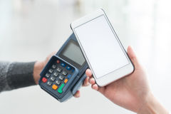 Customer pay by cellphone. With empty screen, great for your design Stock Photography