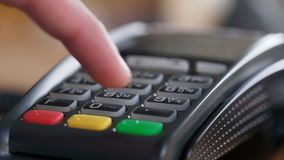 Customer pay over wireless tradings card-reader. Closeup shot of customer pay over the wireless tradings card-reader. Adult human hands of businessman use stock footage