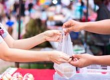 Customer paying bill by cash at market. Customer paying bill by cash at open air market Stock Photography