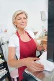 Customer paying at butcher shop Stock Photos