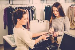 Customer paying with card in a showroom Stock Image