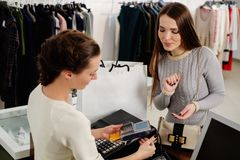 Customer paying with card in a showroom Stock Photos