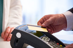 Customer paying with contactless card. NFC technology payment in store. Close Up. Shopping in pharmacy Royalty Free Stock Photo