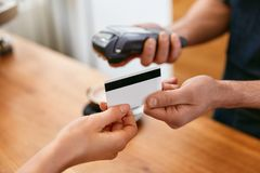 Customer Paying With Credit Card In Coffee Shop Closeup. High Resolution stock image
