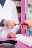 Customer paying with credit card for pills Royalty Free Stock Photo