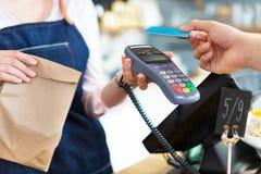 Customer Paying Through Credit Card Royalty Free Stock Image