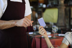 Customer paying with credit card at the restaurant Stock Image