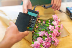 Customer paying in flower shop Stock Photos