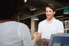 Customer paying her bread to waiter Royalty Free Stock Photo