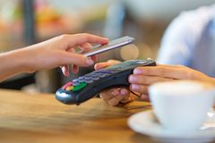 Customer Paying Through Mobile Phone Royalty Free Stock Images