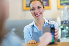 Customer Paying Through Mobile Phone Stock Images