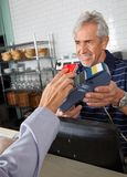 Customer Paying Through Mobile Phone In Store Stock Photo