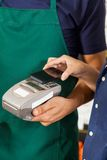 Customer Paying With Mobilephone Using NFC Royalty Free Stock Photo