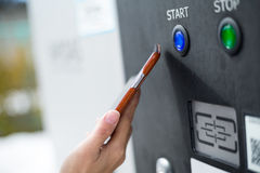 Customer paying with NFC technology on parking system Royalty Free Stock Photos