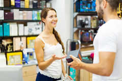 Customer paying for purchases Stock Image