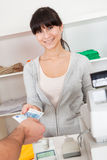 Customer paying in the shop. Customer paying with cash in the apparel shop Royalty Free Stock Image