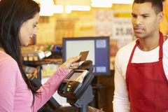 Customer Paying For Shopping At Checkout With Card Royalty Free Stock Photos