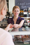 Customer Paying For Shopping In Delicatessen With Credit Card Stock Photos