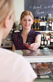 Customer Paying For Shopping In Delicatessen With Credit Card Royalty Free Stock Image