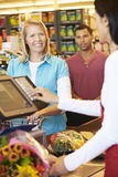 Customer Paying For Shopping At Supermarket Checkout Stock Images