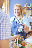 Customer Paying For Shopping Using Credit Card Machine. Customer Paying For Food Shopping Using Credit Card Machine Stock Photos