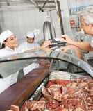 Customer Paying Through Smartphone At Butchery Stock Images