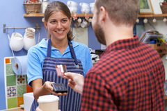 Customer Paying For Takeaway Coffee Using Contactless Terminal Stock Photos