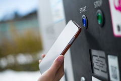 Customer paying though NFC on parking machine. At outdoor Royalty Free Stock Photo