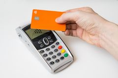 Customer is paying using contactless credit card and payment terminal Stock Photography