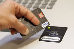 A customer paying using contactless credit cards payment system. stock images