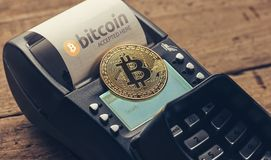 Customer pays by bitcoin to pay a bill at the cafe bitcoin acce stock photography