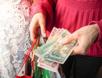 Customer pays dirhams UAE bills cash while shopping. Royalty Free Stock Photo