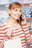 Customer of a pharmacy with paper bag Stock Photo
