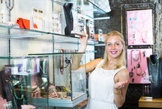 Customer picking earrings in jewellery boutique Stock Photos