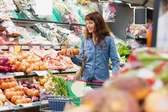 Customer picking onions Stock Photography
