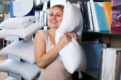 Customer picking soft pillow Royalty Free Stock Photos
