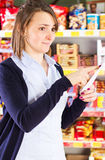 Customer pointing at shopping list  Royalty Free Stock Images