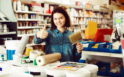 Customer is purchasing tools for house improvements. In paint supplies store royalty free stock photo