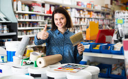 Customer is purchasing tools for house improvements. In paint supplies store royalty free stock photography